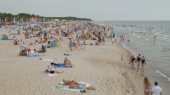 PALANGA, LITHUANIA - July 30, 2016: People relaxing, sunbathing and swimming at Stock Footage