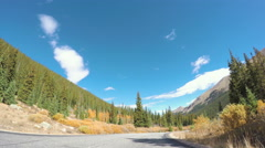 POV point of view - Driving through  alpine forest in the Autumn. Stock Footage