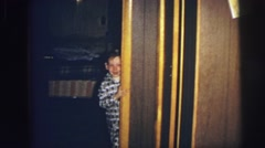 1974: excited children christmas morning coming out to get gifts LYNBROOK Stock Footage