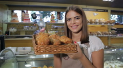 Woman smells croissants Stock Footage