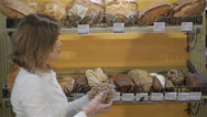 Woman puts black bread on the rack Stock Footage