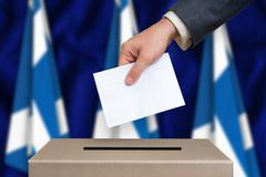 Election in Scotland. The hand of man putting his vote in the ballot box. Sco Stock Photos