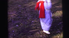 1974: excited toddler dressed warmly twirling outdoor on cool fall day LYNBROOK Stock Footage