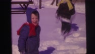 1974: children playing outdoor in the winter LYNBROOK, NEW YORK Stock Footage