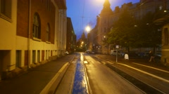 Rear view from train ride at night Helsinki, residential houses at Katajanokka Stock Footage