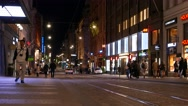 Famous Aleksanterinkatu shopping street at night time, Helsinki downtown Stock Footage