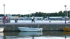 People go on pier on Linnanallas bay in Helsinki South Harbor Stock Footage
