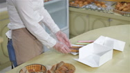 Seller packs brewing cakes at the pastry shop Stock Footage