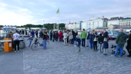 Passengers wait in queue, then come on ferry board in Helsinki South Harbor Stock Footage