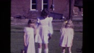 1976: three little girls standing outdoor with easter eggs FORT WAYNE, INDIANA Stock Footage