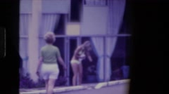 1976: women are seen in beautiful dresses FORT WAYNE, INDIANA Stock Footage