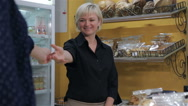 Female seller uses the credit card of the client for payment Stock Footage