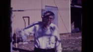 1976: old man standing outdoor pointing upwards FORT WAYNE, INDIANA Stock Footage