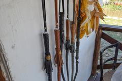 Cossack whip hanging on the wall Stock Photos
