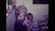 1976: mother with small child is seen FORT WAYNE, INDIANA Stock Footage