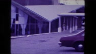 1976: motel holidome style building indoor pool recreation center lounge area Stock Footage