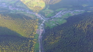 Mountain village near the road in the forest. aerial view Stock Footage