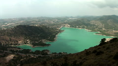 "Wide shoot from above of water reservoir ""Embalse de Amadorio"" in Orxeta, Spa Stock Footage"