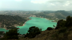 "Wide shoot from above of water reservoir ""Embalse de Amadorio"" with small tre Stock Footage"