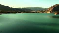 "Zoom from water resevoir ""Embalse de Amadorio"" to the village Orxeta in Spain Stock Footage"