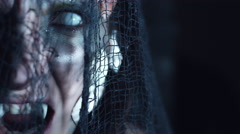 4k Halloween Shot of a Horror Woman Mermaid Posing with Fangs and White Eyes Stock Footage