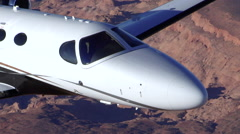 Cessna Citation Mustang Air to Air Zoom Out From Nose Stock Footage