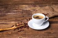 Coffee cup on a wooden table. Dark background Stock Photos