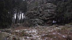 4k Feuersteinklippen rocks monument tilt up mountain range Harz winter Stock Footage