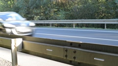 Detail of crash barrier with speeding cars, real time,with sound Stock Footage