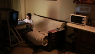 Teen boy plays games on the computer at night. Online Games Stock Footage