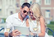 Couple looking at tablet pc in cafe Stock Photos