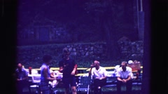 1971: family summer reunion picnic man playing ball by old people talking  Stock Footage