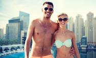 Happy couple in swimwear over dubai city waterside Stock Photos
