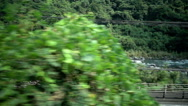 Forest and river view beside street, look through the train window, slow motion Stock Footage