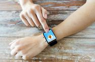 Close up of hands with music player on smart watch Stock Photos