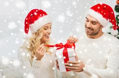 Happy couple at home with christmas gift box Stock Photos