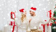 Happy couple with christmas gifts and thumbs up Stock Photos