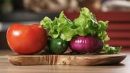 Raw vegetables on kitchen table Stock Photos