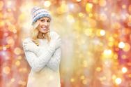 Smiling young woman in winter hat and sweater Stock Photos