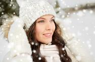 Happy woman outdoors in winter Stock Photos
