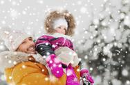Happy family in winter clothes outdoors Stock Photos