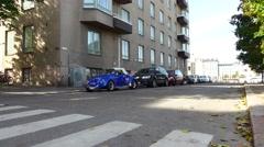 Vivid blue classic Volkswagen beetle parked on Helsinki street Stock Footage