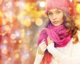 Woman in hat and scarf over christmas  lights Stock Photos