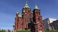 Asian tourists take pictures against Uspenski Cathedral in Helsinki Stock Footage