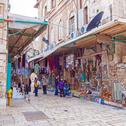JERUSALEM, ISRAEL - FEBRUARY 16, 2013: Tourists buying souvenirs on the stree Stock Photos