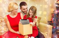 Smiling family with tablet pc Stock Photos