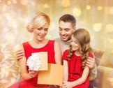 Happy family opening gift box Stock Photos