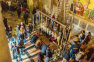 JERUSALEM, ISRAEL - FEBRUARY 16, 2013: Pilgrims praying near Stone of Unction Stock Photos
