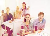 Students showing black blank smartphone screens Stock Photos