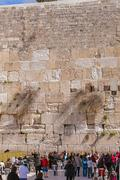 JERUSALEM, ISRAEL - FEBRUARY 17, 2013: People praying near Western Wall Stock Photos